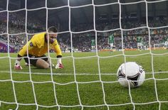 Ireland's goalkeeper Given reacts after Croatia scored their third goal during their Group C Euro 2012 soccer match at the City stadium in Poznan,