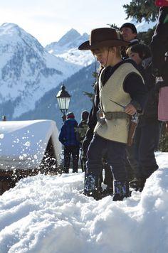 Costumed observer enjoying the Tschaggatta Carnival parade in Lotschental Valley, Switzerland