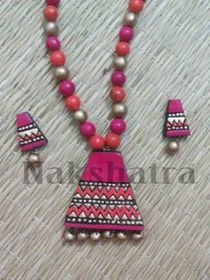 Pink Terracotta Necklace Set. Found them on Jumkey.com. Buy them @ - http://jumkey.com/shop/handicrafts/terracotta-necklace-set-by-nakshatra-8/