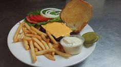 Stop in for one of our 1/2 lb burgers and fries! If you're part of our VIP Club, you'll also get a free brownie. #BilottisPizzaAndItalianGarden #Bilottis #DePere #Pizza #Italian #food