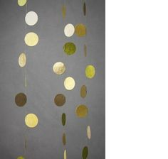 Pretty gold polka dot garland could line a table or near the entrance.