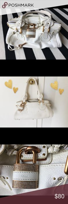 White real leather handbag, bronze, diamonds! 💎 Showpiece handbag! Real leather pebbled grain, copper trim with logos. The bag has an actual working padlock & key! The lock is encrusted with jewels-it's heavy! It works with the 💎 key! So much character & detail went into Sorry, no cards or certs obvi. Pls note the bag latch it showing signs of wear, but you can see in one of the pics that I tuck the latch under and it's better that way because you can see the embossed emblem inside…