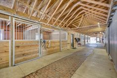 gorgeous and bright barn aisle Horse Stalls, Horse Barns, Horse And Human, Dream Barn, Luxury Life, Victorian Homes, Beautiful Horses, Farm Life, Just In Case