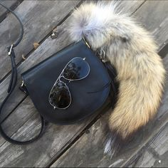 Vintage black leather crossbody Super chic vintage black leather crossbody. Brand is Simone Firenze. A true vintage beauty and in great condition! Adjustable strap! Fur accessory not included. Vintage Bags Crossbody Bags