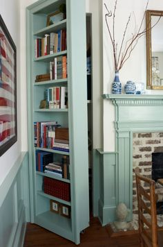Hidden storage behind a built-in bookcase on hinges!