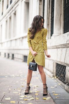 Dots all over. Mustard polka-dots dress+black ankle strap heeled stilettos+black chain short shoulder bag. Fall Evening Event Outfit 2016