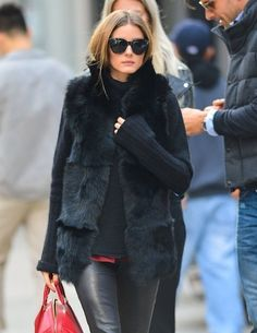 Fur is the new black! Olivia Palermo scores an autumn fashion hit as she wraps up in a chic coat and form-fitting leather trousers Olivia Palermo Fur, Estilo Olivia Palermo, Olivia Palermo Lookbook, Black Biker Jeans, Black Fur Vest, Black Leather, American Girl, Johannes Huebl, Fur Gilet