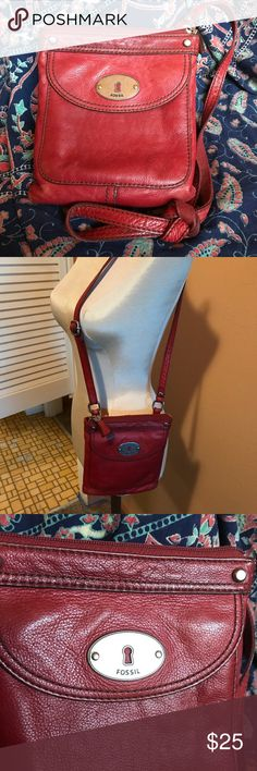 """Fossil Crossbody Shoulder Bag Purse Red Leather Sweet purse for running around and not wanting to my bigger purse! Put in the essentials and throw it over your neck. Super soft substantial red leather. Pocket with magnetic closure in front with credit card slots too. Main zip compartment has smaller zip pouch inside. 7"""" x 8"""". Adjustable strap with approx. 27"""" drop. Strap is leather on one side and canvas on the other. Picture shows some wear in back and corners, however this looks good and…"""