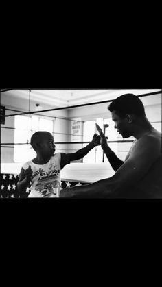 Muhammad Ali with little boy
