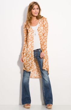 Nordstrom.com...A soft, vintage floral patterns a slightly sheer cardigan fashioned with an elongated silhouette perfect for layering. $40