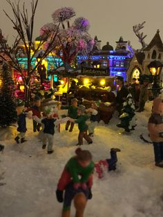 Children playingt in xmas village