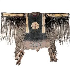 Cheyenne Indian Buckskin Shirt, decorated with quill-work and hair locks.