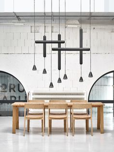 Contemporary minimal chandelier over a dining table