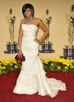 Taraji P. Henson gave us this frothy Roberto Cavalli strapless number in 2009. Love Cavalli; he captured the silhouette and softness in this dress. Her hair is also very simple and is not in competition with the dress.