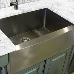 This stainless steel kitchen sink makes a perfect addition to your next kitchen remodel. With a modern farmhouse apron style, this sink's unique shape has been perfectly designed to accommodate your special design needs. Stainless Farmhouse Sink, Farmhouse Apron Sink, Stainless Steel Farmhouse Sink, Stainless Kitchen, New Kitchen, Kitchen Decor, Kitchen Design, Kitchen Sinks, Kitchen Ideas