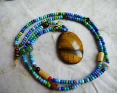 Synthetic Cat Gut Seed Bead and Random Gemstone & Tiger Eye Pendant Necklace by cherokeedancing. Explore more products on http://cherokeedancing.etsy.com