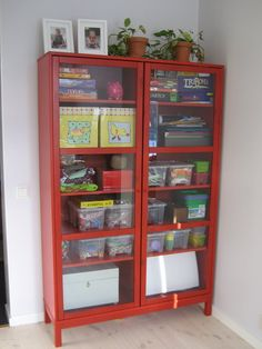 I love this red Ikea shelf, which holds board games and kids toys and bits and pieces.