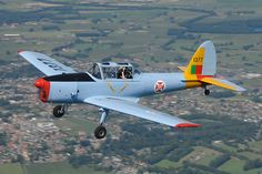 Air to air shot of a  DHC-1 Chipmunk in Portugal Air Force colours above Belgium.