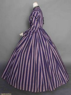 "Purple Stripe Day Dress, 1860s, Augusta Auctions, November 12, 2014 1-piece, light weight wool woven in alternating dark & light purple stripes w/ orange pin stripes, jet F buttons & trims, cap sleeve w/ jet tassels, brown cotton bodice lining, B 35"", W 27.5"", L 54""-59"", (scattered small holes in skirt, loose beads, few light skirt stains) very good."