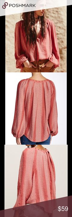 """🆕 Free People Against All Odds desert sunset - Split neck - Long sleeves with banded cuffs - Grommet trim - Allover stripes - Approx. 27"""" length - Imported Fiber Content: 81% rayon, 19% cotton Care: Machine wash cold Fit: this style fits true to size. Brand new with tag. Retail price $128. Free People Tops Blouses"""