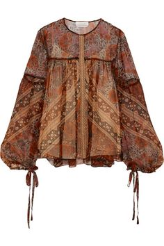 Chloé's featherweight blouse epitomizes the brand's feminine, bohemian spirit. This sheer silk-crepon style has a brown, burnt-orange and raspberry foulard print and wispy peasant sleeves - the drawstring ties emphasize their billowy shape beautifully.