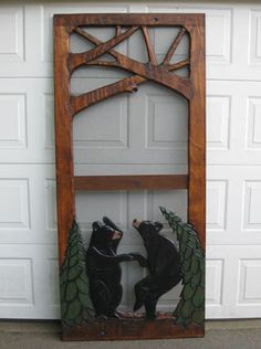 Dancing bears carved screen door