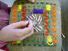 Fourth Grade students drew out a plan for their designs that included radial balance, which means that their designs have two lines of symmetry. Then, they started learning the different stitches: running stitch, straight stitch, cross-stitch, and satin stitch. Using burlap cloth as our fabric is helpful since it is loosely woven and much easier to sew with the large diameter yarn.
