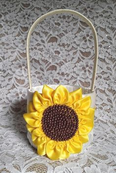 Ivory Flower Girl Basket, Sunflower flowergirl basket, Sunflower with Yellow Satin Trim and Lace / Wedding Basket, Sunflower Wedding by AllAHeartDesires on Etsy https://www.etsy.com/listing/198318589/ivory-flower-girl-basket-sunflower
