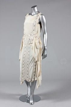 Evening dress, ca 1928 - Bust is 82-86cm/32-34in, about a size 4-8 UK/0-4 US.  (Below) Wedding or court presentation dress, ca 1922 - Bust is 92cm/36in, about a size 12 UK/8 US.  Click to go to the absentee bidding page.  This Kerry Taylor auction will end October 16th at 2:00 PM GMT (9:00 AM EST).  You will need to register to bid ahead of time.