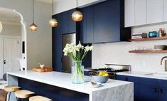 Kitchen Design Ideas - Deep Blue Kitchens // The elements of dark blue are brightened up with the light marble island and backsplash in this modern kitchen. Kitchen Cabinets Color Combination, Kitchen Colour Schemes, Kitchen Cabinet Colors, Color Schemes, Kitchen Hutch, Kitchen Wood, Navy Kitchen, Two Tone Kitchen, Kitchen Decor