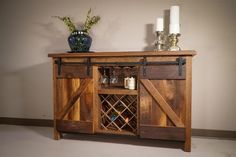 Amish Reclaimed Oak Wood Sliding Barn Door Buffet Urban Reclaimed Barnwood Urban Chic at its finest with this Sliding Barn Door Wine Cabinet. Handcrafted by our skilled Amish Craftsman Amish Furniture, Wood Furniture, Sliding Glass Dog Door, Diy Doggie Door, Wine House, Wine Cabinets, Reclaimed Barn Wood, Wood Bars, Interior Barn Doors