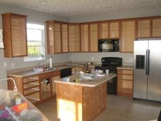 how to paint kitchen cabinents that have laminent on it. sandeddeglossed kitchen