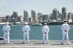 Sailors overlook San Diego Bay as they man the rails on the flight deck of the Nimitz-class aircraft carrier USS Ronald Reagan (CVN 76) while departing Naval Base Coronado (NBC).