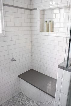 hexagon in the shampoo area and use large white tile instead of subway