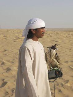 A falconer and his bird - taken in the desert in Dubai