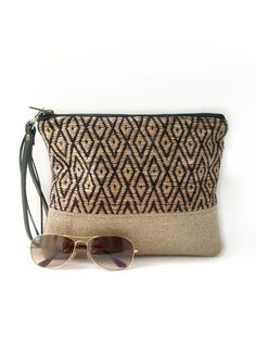 This casual, woven clutch bag with detachable, leather wrist strap blends modern fabrics, simple styling and a neutral color palette. Wonderfully textured, super sturdy, and visually distinctive; it w
