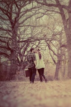 Couple kissing in woods - Natural Light Photography