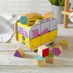 Your little one will love this personalised shape sorter featuring Peppa Pig's camper.