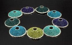 ARLINE FISCH BLUE BARNACLES, NECKLACE  Sterling silver rings, crocheted coated copper wire