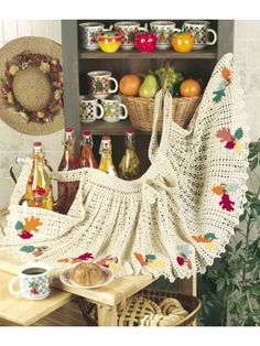 """You'll make a stylish splash in the kitchen on Thanksgiving Day when you wear this marvelous acorn apron! Size: Apron front waistband: 20"""". Apron length: 17"""". Apron width at base of skirt: 80"""".Skill level: Easy"""