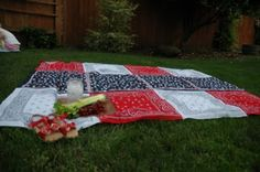 Bandana table cloth/picnic blanket.  I can use some old fabric I have to back it, perfect!