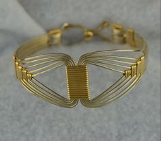 EGYPTIAN bracelet wirewrapped Sterling Silver and 14K gold filled.