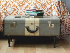 Upcycling -- Attach some antique table legs to an old suitcase to make a sweet little storage unit for the end of your bed