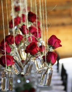 Bud vases hung from twine make a colorful focal point for weddings and events. Romantic for Valentine's Day too! See all our glass bottles here: http://www.lightsforalloccasions.com/c-400-bottles-jars.aspx