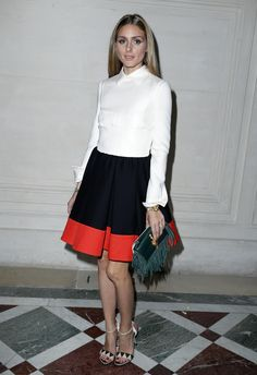 Palermo took a classic collared shirt and paired it with a black skirt, but, of course, she selected one with a candy-red border and accessorized it with an emerald clutch and funky sandals.