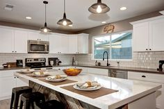 Flip Friday | Blissful Abode Interiors | Phoenix Home Staging Company Reclaimed wood island, Taupe quartz, white cabinets, black cabinet hardware, home staging, home flipping