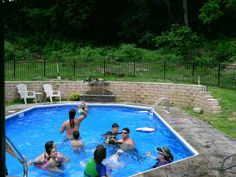 W/retaining wall, water fountain and fencing.  Country pool.