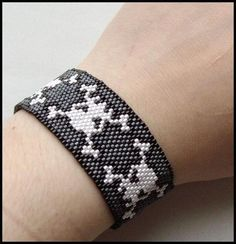 Cleverly patterned peyote skull & crossbones bracelet by Canadian artist Sarah Langille (threadedmetal) ~ love the design!