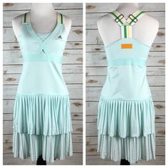 """[Adidas x Stella McCartney] Pleated Tennis Dress Gorgeous and unique tennis dress. Pretty light aqua color. Cool adjustable striped elastic straps. Flattering seaming and detailing. Bra is lined. Comes with shorts for underneath, shown in last photo.   Color: Aqua, White, Green, Yellow Fabric: ClimaCool Size: 36 (A size Small) Bust: 14"""" Length: 34"""" Condition: NWT!  No Trades! No PayPal! Adidas by Stella McCartney Dresses"""