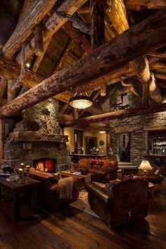 big logs in this amazing log cabin.  Love all of the stonework!